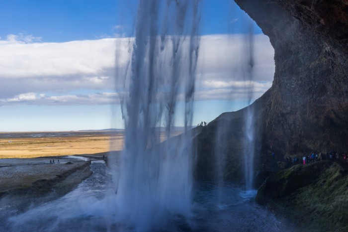 Seljalandsfoss waterfall in southern iceland. A passage behind the water is accessible to tourists