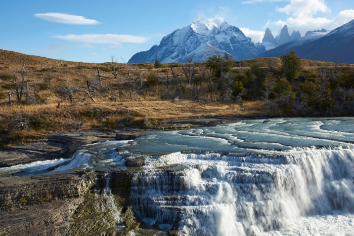 """The waterfall """"Cascada Paine"""" on the River Paine in Torres del Paine National Park in the Magallanes region of southern Chile."""