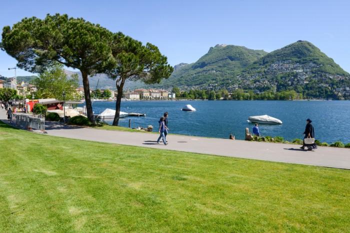 Lugano, Switzerland - 5 may 2016:  People walking on the lakeside of Lugano on the italian part of Switzerland