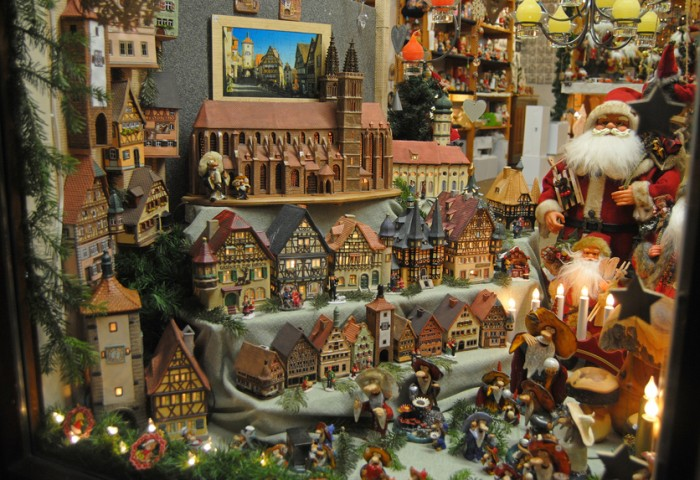 Rothenburg ob der Tauber, Germany – December 18, 2013. Shop window in Rothenburg ob der Tauber during Christmas, with santa clauses, historic candle houses, toys and candles.