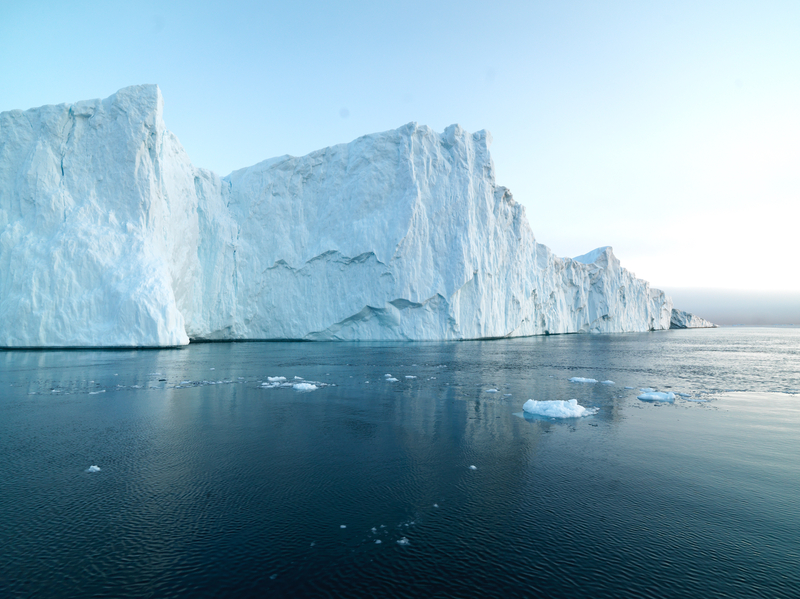 long beautiful iceberg on arctic ocean. The icebergs are melting day by day. Greenland recorded to UNESCO world heritage list.