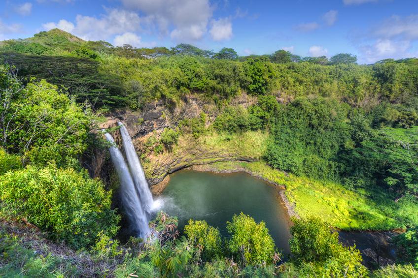 Wailua Falls. The Wailua Waterfall on the island of Kauai flows into the Wailua River. Kauai Island, Hawaii