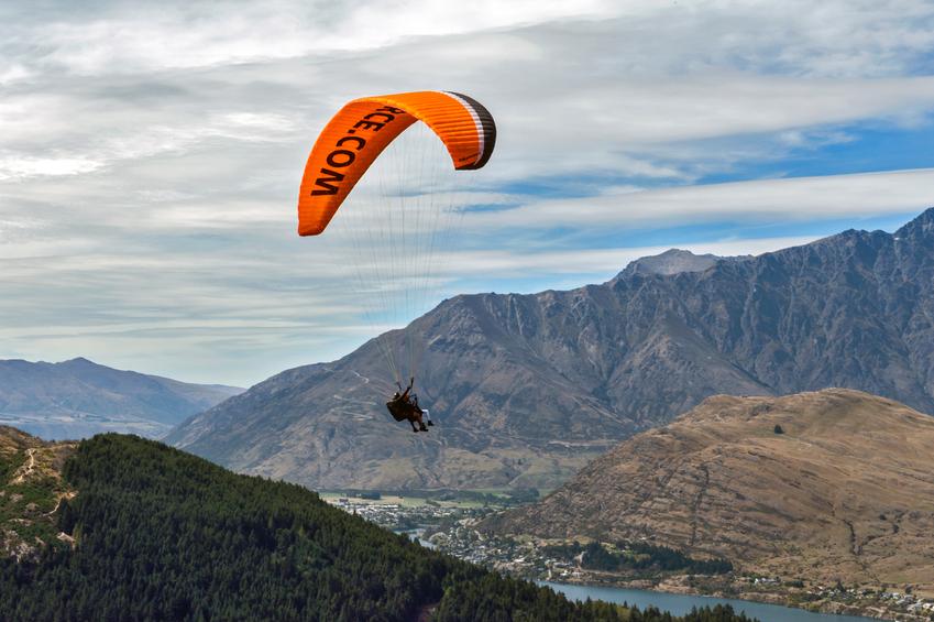 Queenstown, New Zealand - March 1, 2016: Tandem paragliding over Lake Wakatipu in Queenstown, New Zealand
