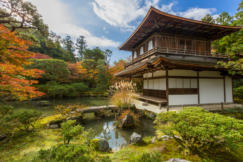 """Kyoto, Japan - November 21, 2015: Ginkaku-ji, the """"Temple of the Silver Pavilion,"""" is a Zen temple founded in 1490. Ginkaku-ji was originally built to serve as a place of rest and solitude for the Shogun. Ginkaku-Ji is a popular tourist site, which was listed by UNESCO as a World Heritage site in 1994."""