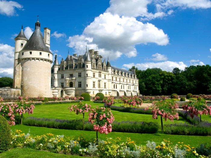 """Chenonceaux, France - July 21, 2008: Chenonceau Castle was built in 1513 by Katherine Briçonnet. This awesome site is well known because its special design, its furniture and decorations, with an exceptional museum collection of old paintings of Murillo, Le Tintoret, Nicolas Poussin, Le Corrège, Rubens, Le Primatice, Van Loo... as well as an extremely rare selection of Flanders Tapestries from the 16th century."""