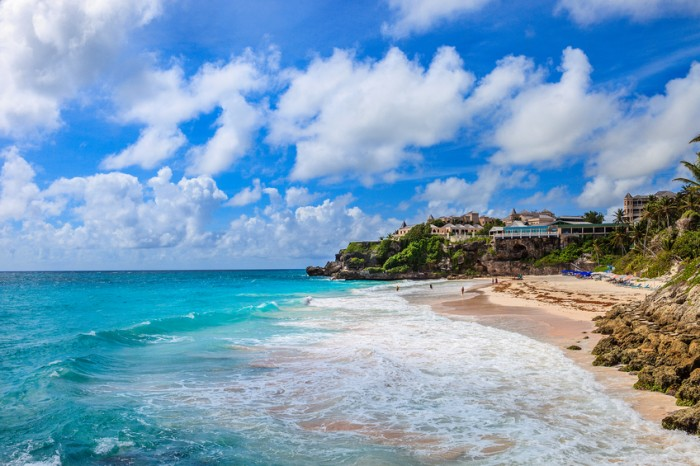 """The Crane Beach, located on the south coast of Barbados, is considered to be one of the island's most beautiful beaches. On the top of the cliff stands the Crane Hotel, one of the most famous Barbadian hotels."""