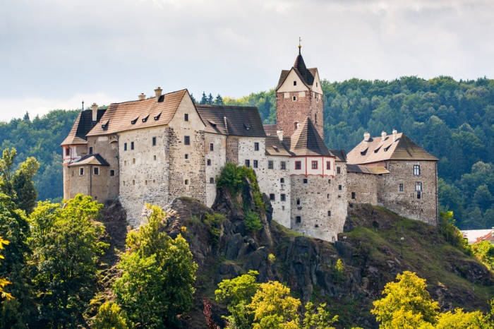 Loket, Czech Republic - August 13, 2012: Old castle located on the hills near city with the same name. Czech Republic