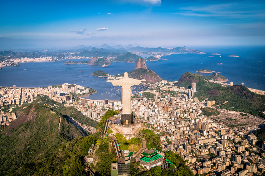 Rio De Janeiro, Brazil - February 11, 2015: Rio de Janeiro, Brazil : Aerial view of Christ and Botafogo Bay from high angle. Statue is located on Corcovado Hill and is facing the city and Guanabara Bay.