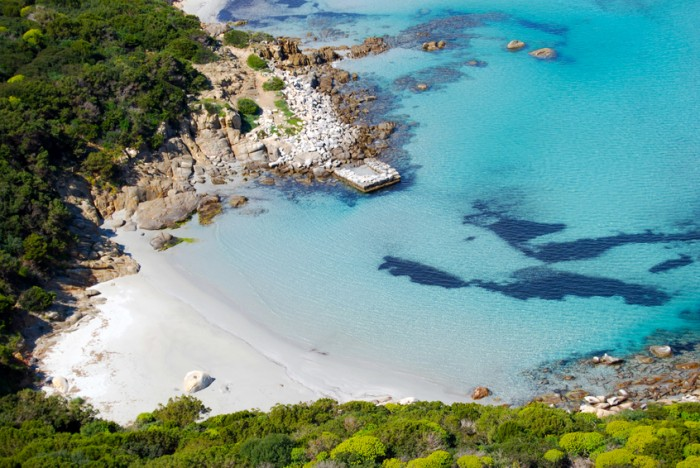 colorful coastal nature in Villasimius (Sardinia) with sea mountain. Lagoon of Porto Giunco for tourism