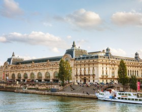Paris, France - October 9, 2014: D'Orsay museum with people in Paris, France. The Musee d'Orsay is the French art  museum in Paris, on the left bank of the Seine.