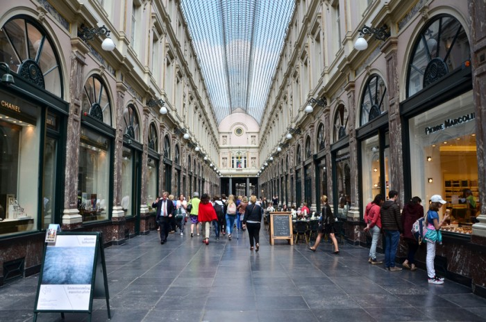 Brussels, Belgium - May 12, 2015: Tourists shopping at The Galeries Royales Saint-Hubert in Brussels, Belgium. This place is a glazed shopping arcade in Brussels that preceded other famous 19th-century shopping arcades.