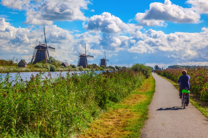 Kinderdijk, Netherlands - September 04, 2015: windmills with unidentified people in Kinderdijk. The place is one of the best-known Dutch tourist sites and UNESCO World Heritage Site since 1997
