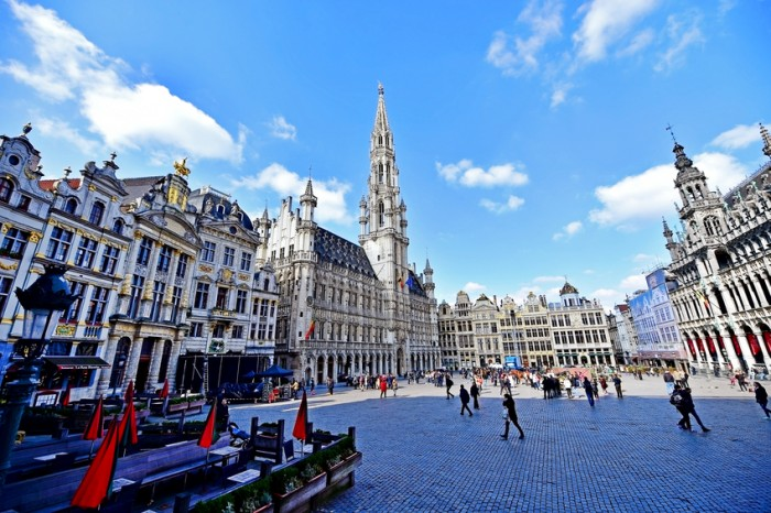 Brussels, Belgium - March 16, 2016: Wide angle shot with tourists visiting the Grand Place in Brussels.