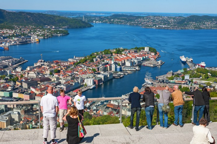 Bergen, Norway - May 24, 2008: Tourists looking out over the city Bergen in Norway, from the mountains view point.