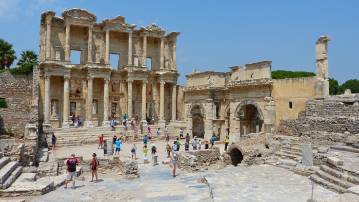Ephesus, Turkey – August 11, 2013. Ruins of the Library of Celsus in Ephesus - the third largest library in the ancient world, with people.