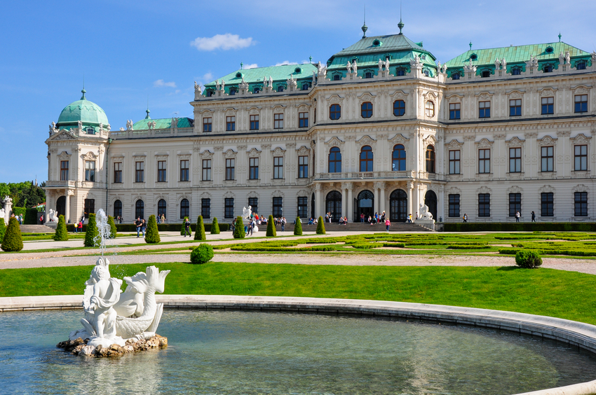 Vienna, Austria - May 14, 2016: Fountain in front of Upper Belvedere Palace on May 14, 2016 in Vienna. A Baroque palace Belvedere is a historic building complex in Vienna, consisting of two Baroque palaces with a beautiful garden between them.