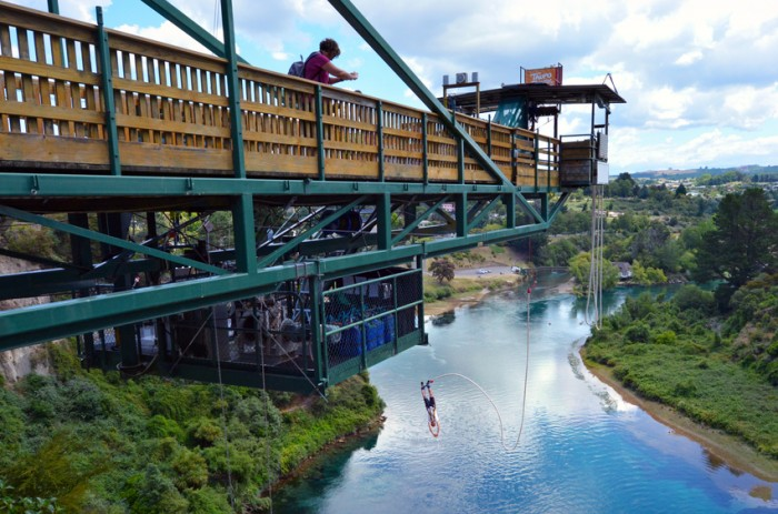 Taupo, New Zealand - January 14, 2016: Person in mid air during a bungy jump from 47 metres (154 feet) in above the Waikato River in Taupo, New Zealand.