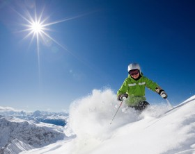 Female skier with smiley face3 and with mountain view in Davos, Switzerland.