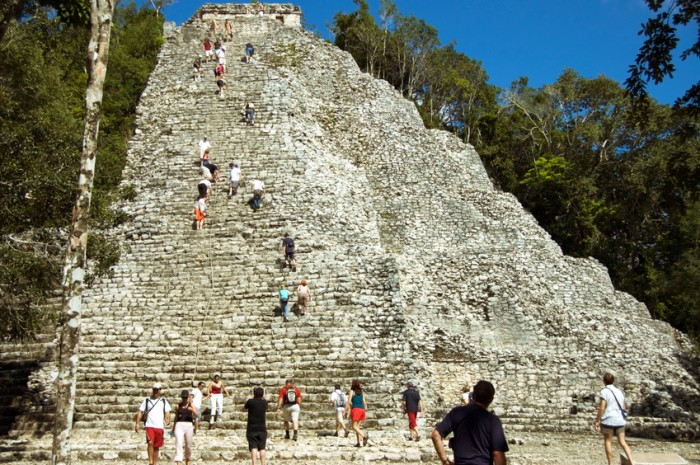 Tourists hardly making it  to the top of the Coba Main pyramid, highest Maya  structure standing 40 Meters above the Yucatan jungles,   MAYA here date from the 6oo's AD.
