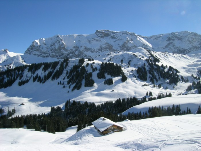 Mount Wildstrubel and snow-covered alpine hut at Adelboden (Bernese Oberland)