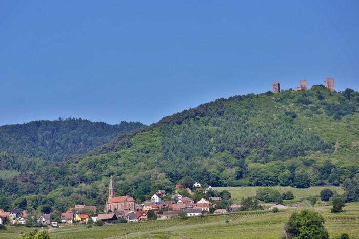 "This photo shows ""Les trois ch?teaux d'Eguisheim"", the three castles of Eguisheim."