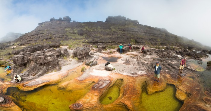 Canaima National Park, Venezuela - April 3, 2015: Panorama of group of hikers at the natural rock formations on the top of Mount Roraima which serves as natural swimming pools. Tourists use it mainly as a bathroom. Gran Sabana. Venezuela 2015.