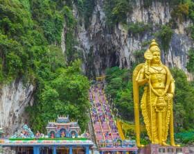 Batu Caves Lord Murugan Statue and entrance near Kuala Lumpur Malaysia. A limestone outcrop located just north of Kuala Lumpur, Batu Caves has three main caves featuring temples and Hindu shrines.