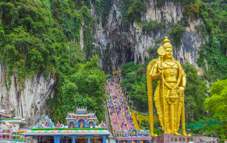 Batu Caves Lord Murugan Statue and entrance near Kuala Lumpur Malaysia. A limestone outcrop located just north of Kuala Lumpur, Batu Caves has three main caves featuring temples and Hindu shrines.