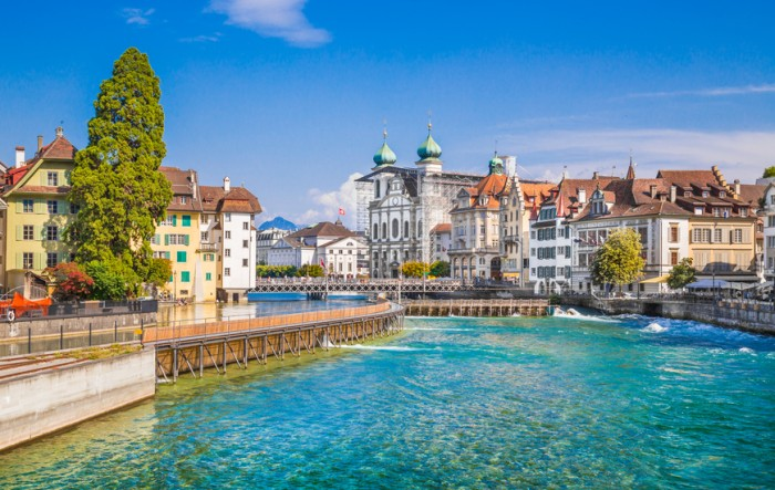 Beautiful view of the the historic city center of Lucerne with famous baroque Jesuit Church St Franz Xaver on a sunny day with blue sky and clouds in summer, Canton of Lucerne, Switzerland.