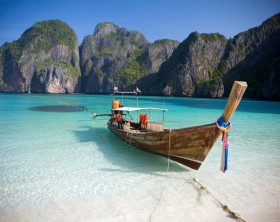 A Long Tail boat sits in the beautiful Maya Bay, Ko Phi Phi Ley, Thailand