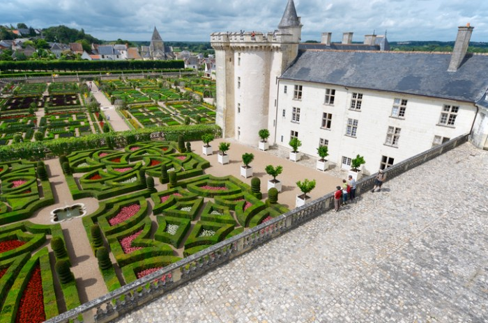 """""""Villandry, France - August 13, 2012: tourists walk in Villandry Castle. This castle was built around 1536 and after its abandonment was rebuilt by Joachim Carvallo in the early 20th century. Villandry Castle was one of the first castles of the Loire which opened to the public."""""""