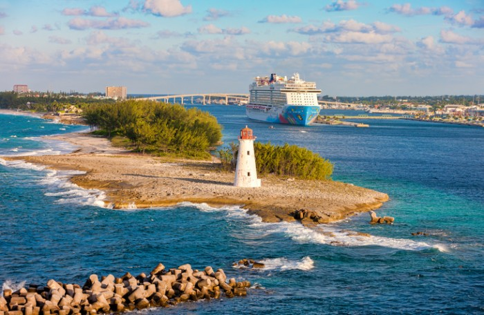 Nassau, Bahamas - October 10, 2014: Scenic view of the lighthouse, cruise port and resort in the Bahamas. The tropical climate and natural beauty of the Bahamas have made Nassau a popular tourist destination.