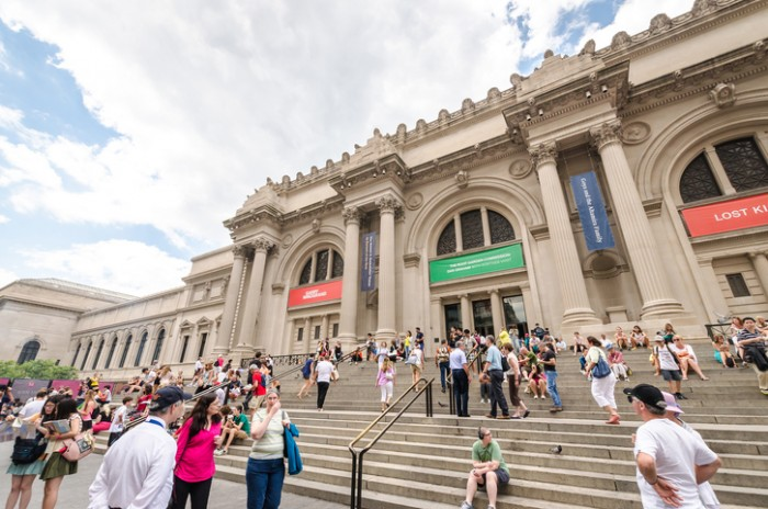 New York, USA - July 17, 2014. People near the entrance into Metropolitan Museum of Art. The Metropolitan Museum of Art is the largest art museum in the United States.