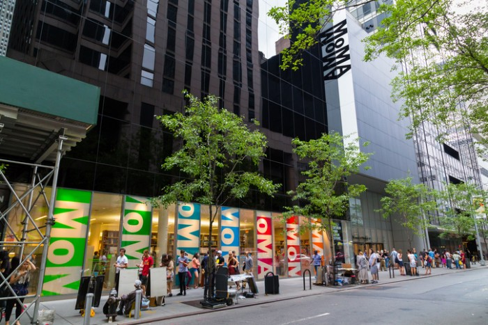 New York City, USA - August 30, 2014: The outside of the Moma Museum in central New York. People can be seen outside
