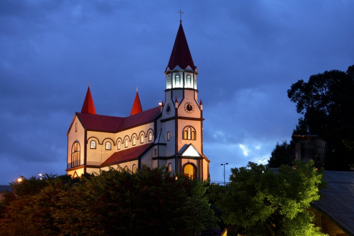 Floodlit wooden church in Puerto Varas in Chile, South America.