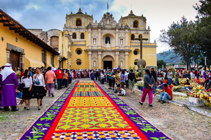 Antigua, Guatemala - April 1, 2007: Holy Week carpet (or alfombra) made in the path of a religious procession using wooden stencils and dyed sawdust, La Merced Church,