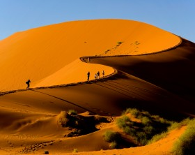 Tourists climbing Sossusvlei dune, Naukluft National Park, Namibia