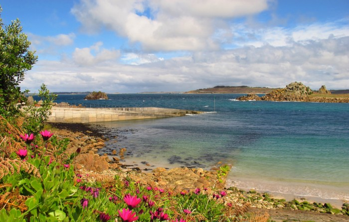view of turquoise sea off the coast of St. Agnes island in England's Isles of Scilly in Cornwall