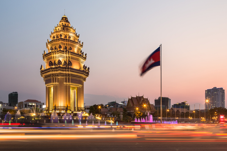 Traffic rush around the Independence monument, with its Khmer architecture style, in Phnom Penh, Cambodia capital city. Blurred motion archived with long exposure.