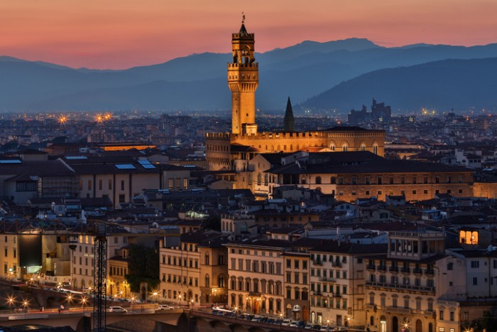 Florence, Italy - September 1, 2016: The Palazzo Vecchio and the city of Florence at night - viewed from Piazzale Michelangelo. In 1982, the historic centre of Florence was declared a UNESCO World Heritage Site