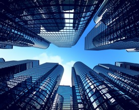 Low angle shot of modern glass city buildings during sunny day. Fisheye lens effect.