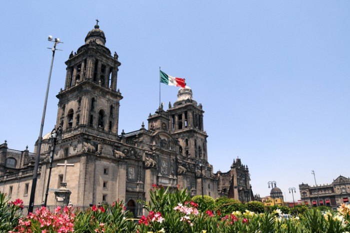 Mexico City Metropolitan Cathedral (Catedral Metropolitana de la Asunción de María) is the largest and oldest cathedral in the Americas, built in 1573-1813, and seat of the Roman Catholic Archdiocese of Mexico, seen here with flowers planted on the Zocalo Square.