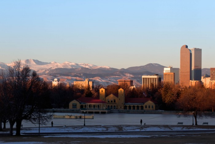 Eary morning sunrise on Denver City Park in the winter with a frozen lake
