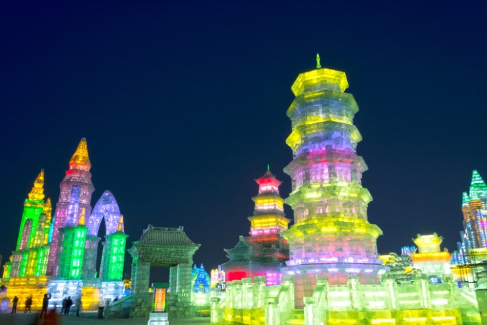 Harbin, China - December 30, 2013: Harbin Ice and Snow World. People are walking. Located in Harbin City, Heilongjiang Province, China.