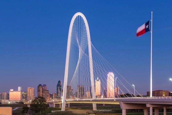 Dallas downtown skyline with Margaret hut hills bridge at night.