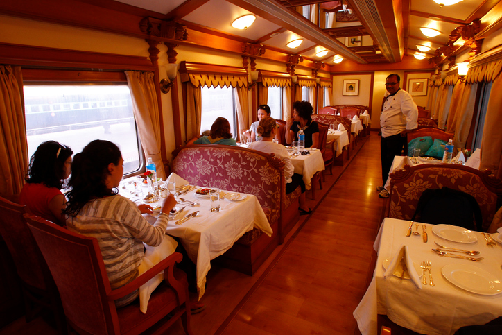 """Mysore, India - October 11, 2011: Restaurant wagon of The Golden Chariot, a luxury tourist train that connects the important tourist spots in the Indian states of Karnataka. The train is designed to be a """"Palace on Wheels"""" and features two multi-cuisine restaurants—Nala and Ruchi—serving a buffet spread of vegetarian and non-vegetarian cuisine."""
