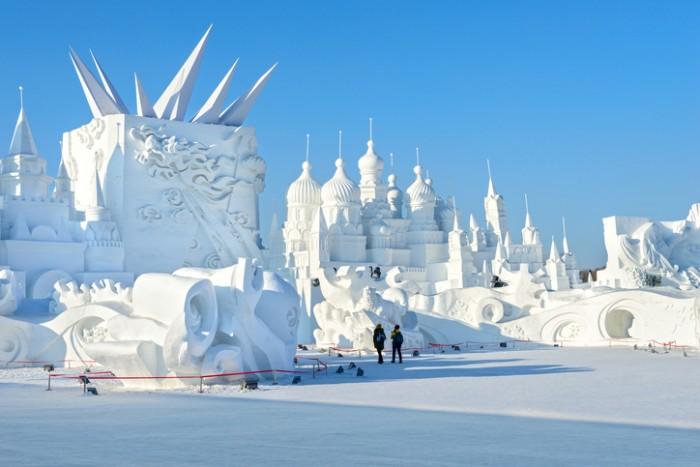 Harbin, China - January 11, 2015: Snow building. People are visiting. 27th China Harbin Sun Island International Snow Sculpture Art Expo. People are visiting. Located in Harbin City, Heilongjiang, China.