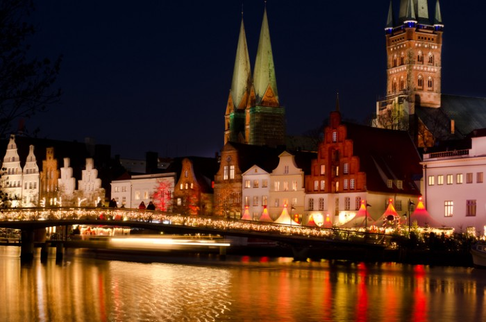 Luebeck, Christmas mood at the obertrave with churches st.marien and petri Tower