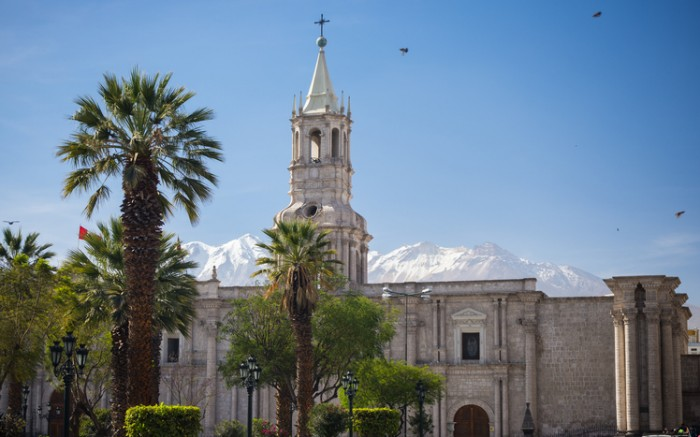 The colonial Cathedral of Arequipa, famous travel destination and landmark in Peru. The snowcapped Volcano El Misti in the background.