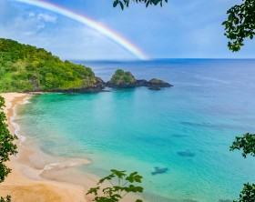 Rainbow in Praia do Sancho beach, Fernando de Noronha, Brazil